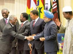 Prime Minister Manmohan Singh greets South African president Thabo Mbeki at the India-Africa Forum Summit on Tuesday