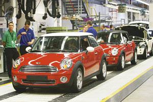Small luxuries: Minis on the assembly line at a BMW plant in Cowley, the UK. BMW will import the car in India as fully-built units. (Suzanne Plunkett / Bloomberg)