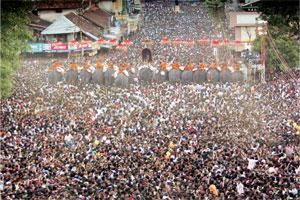 Mass following: A file picture of spectators during pooram in Thrissur. Hotels and flats in the town make arrangements on their terraces for people to witness the festival, charging Rs750-1,000 per pe