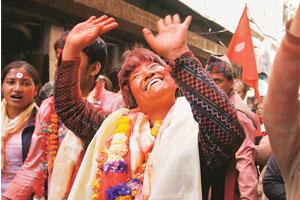 The Maoist march: Hishila Yami of the Communist Party of Nepal (Maoist) waves to public as she, along with supporters, takes out a victory rally in Kathmandu after winning a seat in the recently held