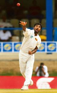 New game: Muttiah Muralitharan, Sri Lankan bowler. Team owners are insuring foreign players too.  (AFP)