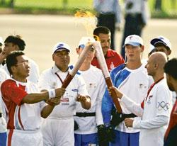 The Olympic torch being passed on in New Delhi, even as thousands of Tibetan protesters demonstrated in the city