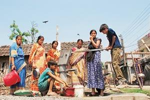 "Source of life: People draw water from a tube well at Baghajatin, Kolkata. According to a study, 77 of the 141 wards in the city have ""high levels"" of arsenic in groundwater and scientists say prolong"
