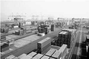 Eligibility criteria: An aerial view of containers being offloaded at a port in Mumbai. The model concession agreement excludes shipping firms.
