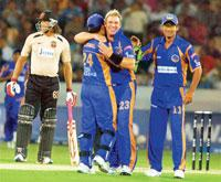 Getting popular: Shane warne celebrates the dismissal of V.V.S. Laxman with teammates during an IPL match in Hyderabad on Thursday. (Photo: PTI)