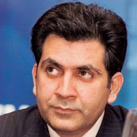 Looking for a partner: Unitech's Sanjay Chandra. The company will invite financial bids from multinational telecom firms from today.