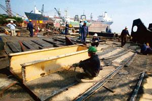Final destination: A file photo of workers dismantling a ship at the Alang shipyard.