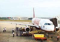 Making way: A file photo of a Kingfisher Airlines plane at the HAL-run Bangalore airport. The airport will remain open for flights carrying senior government officials, business charters and helicopte