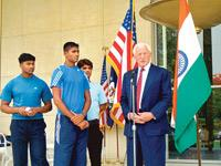 Different ball game: (from left) India's Dinesh Patel and Rinku Singh, winners of a nationwide baseball pitching contest, with US ambassador to India David C. Mulford (right) in New Delhi last week.