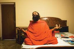 Baba Ramdev alternately charms, humours and hectors his followers, offering tips on eating habits to child rearing with dry wit, in between yoga poses (Photo b y: Harikrishna Katragadda/ Mint)