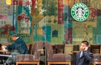 Catching on: A Starbucks coffee outlet in Shanghai, China. With the burgeoning Indian middle class, it is becoming fashionable to drink coffee in outlets similar to Starbucks, such as Barista and Cafe