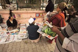 Print line: A newsvendor in New Delhi. Media buyers say a single readership currency would suit the industry.