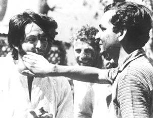 Colour burst: Naqvi (right) applies colour to McCartney on Holi at the ashram. (Photograph courtesy Saeed Naqvi)