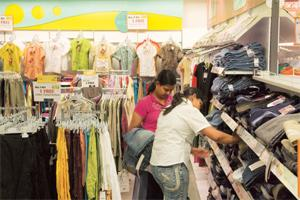 Right fit: A file photo of customers choosing jeans at Big Bazaar in Noida. The Indian jeanswear market is pegged at around Rs6,000 crore.