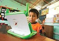 Glued: Renzo, 8, reading on his XO laptop in Arahuay, an Andean hilltop village in Peru. Some 300,000 kids are using OLPC laptops and another 300,000 will receive them soon