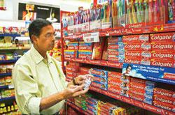 A shopper at a grocery store in Mumbai. Colgate's market share has stayed stagnant over two years, 2006-07 and 2007-08