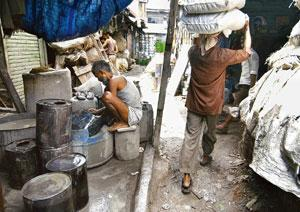 Driving force: Workers at Dharavi — Asia's largest slum — in Mumbai. The survey said almost 53% — of both the chronically poor and those who have never been poor — cited own initiative as the reason f