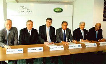 Done deal: (from left) Don LeClair, executive vice-president and CFO of Ford Motor Co.; Lewis Booth, executive vice-president of Ford Motor Co., who has responsibility for Ford Europe, Volvo, Jaguar a
