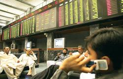 Ominous signs? Traders at the Karachi Stock Exchange. The KSE-100 has fallen 23% from its April highs.