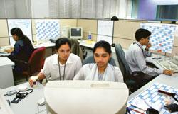 Employees at Infosys Technologies in Bangalore. The study says 48% of employers in India plan to add staff during the three months beginning July, and only 1% expect to reduce the headcount  (Photo by