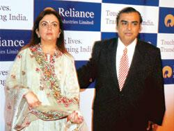 Reliance Industries chairman and managing director Mukesh Ambani along with wife Nita at the annual general meeting of the company in Mumbai on Thursday (Photo by: Santosh Hirlekar / PTI)