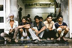 Meal ticket: Men wait outside one of the many charity restaurants known as Wardi hotels in Mahim in Mumbai. (Photo: Michael Rubenstein/HT)