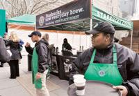 Value proposition: Starbucks employees hand out samples in New York. The coffee giant allowed loyalists to define changes in the company and got back to them on what they were doing about it. (Photo: