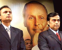 A file photo of Anil Ambani (left) head of the Reliance  Anil D Ambani Group with his brother Mukesh head of RIL (Photo by: Sebastian D'Souza/AFP)