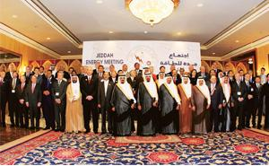 Relief time: Delegates pose with Saudi Arabian officials at the Jeddah energy meeting. Saudi Arabia agreed to raise production by 550,000 bpd to 9.7 million bpd from July to counter rising global oil