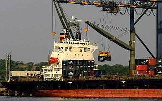 A container is off-loaded from a ship docked at Jawaharlal Nehru Port , Navi Mumbai. Globally, the cargo shipping industry has a fleet size of 55,000 and employs 1.2 million people on-board.