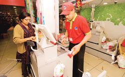 Expanding base: A Reliance Fresh store in Jhandewalan in Delhi. The firm couldn't launch the stores in the state last year because of resistance from the Forward Bloc, but has continued to acquire pro