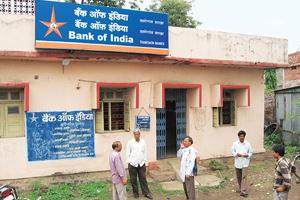 Outstanding concerns: Farmers at Bank of India's Thanegaon branch in Vidarbha. Banks fear it will now become difficult to recover loans. Photograph: Mehak Kasbekar / Mint