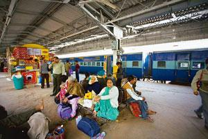 No progress: Passengers wait for trains at the New Delhi railway station. The Rs6,000 cr project to modernize the station, bids for which were to be decided by September, is among several mega project
