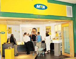 Grace period: An MTN mobile shop in Cape Town, South Africa. Exclusive talks between MTN and RCom are due to end on 8 July.