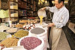 Aiming high: A shopkeeper selling pulses. Gujarat is targeting a 22% increase in pulses production to 800,000 tonnes in 2008-09.