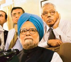 Prime Minister Manmohan Singh addresses the media on way to Japan for the G-8 Summit, on Monday. National security adviser M.K. Narayanan (right back) is also seen (Photo by: PTI)