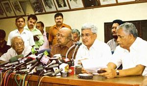 Parting of ways: CPM's Prakash Karat (second from right) announces his party's withdrawal of support for the UPA government on Tuesday. (Raveendran / AFP)