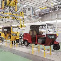 Hard-hit: A file photo of a TVS Motor Co. plant at Hosur, south of Bangalore. For the automobile industry, revenue growth will be offset by declining margins as input costs are rising.