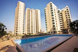 Still bullish : A file photo of a residential complex in Gurgaon. Although brokers say property sales have slowed by 30% in Delhi's suburbs, Ansal says it has already sold 200 plots in the proposed to