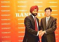 Deal's on: A file photo of Ranbaxy Labs' Malvinder Singh (left) and Daiichi Sankyo's Takashi Shoda. On Tuesday, Ranbaxy approved issuance of 46.26 million shares to Daiichi at Rs732 a share
