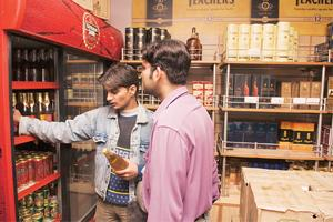 Wider choice: Customers at a beer and wine outlet in New Delhi. Annual per capita consumption of beer in India is estimated at less than 1 litre.