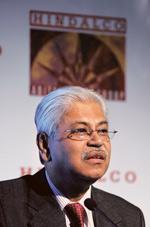 Finance plan: Hindalco managing director Debu Bhattacharya. The firm also plans to raise debt and liquidate part of its treasury investments in bonds and other instruments to close a bridge loan it ha
