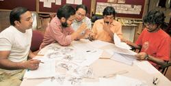 Team work: Gond artists Rajendra Kumar Shyam (extreme left) and Venkat Raman Singh (in peach-coloured shirt) with students from the National Institute of Design at an animation workshop held at the In
