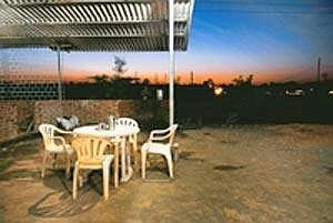 Chairs await customers at Wagheshwar Dhaba & Snacks Corner on the NH4