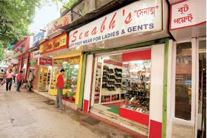 Hard times: Chinese shoe shops at Kolkata's Bentinck Street. Sales at these stores that are struggling to keep up with shifting tastes and styles are falling by almost 10-15%.