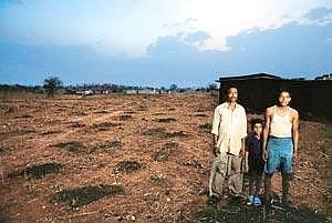 Better deal: Krishna Dayal Shah (left) with his son (centre) and brother at their farm in Siddhi Khurd village in Singrauli. Their land will be acquired for the proposed R-Adag power project. Photogra