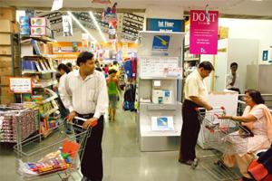 Taxing times: Shoppers at a Big Bazaar outlet. Retail companies say the service tax will hurt them as they are already reeling under soaring rentals charged by mall developers.