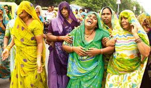 Grief-stricken: Relatives of victims of the serial bomb blasts at a funeral procession in Ahmedabad on Sunday. Photograph: Amit Dave / Reuters