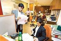 Larger play: Employees at Karanjawala and Co., a law firm in New Delhi. The apex court has asked the council to let lawyers also give details of experience and specialization in their online ads
