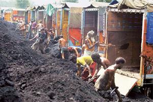 Power plans: Labourers load coal on to trucks on the outskirts of Jammu. India plans to add 78,577MW power generation capacity by 2012. Of this, around 46,600MW is expected to come from coal-based pro